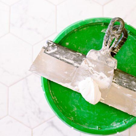 green-lid-with-metal-scraper-3616755